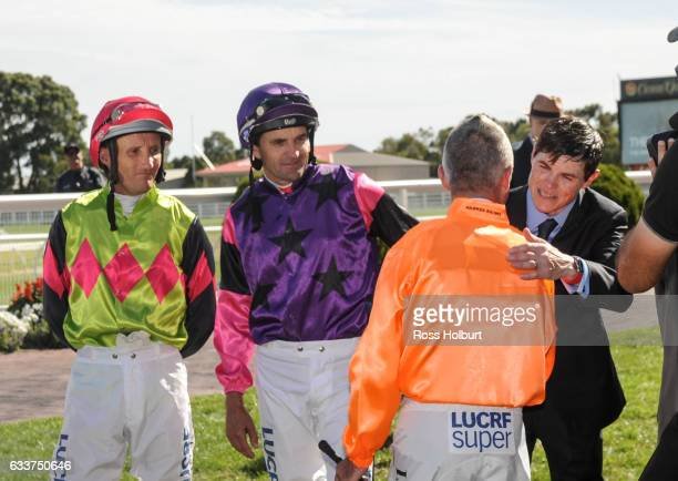 Damien Oliver Dwayne Dunn and Craig Williams farewell Darren Gauci before his final race at Caulfield Racecourse on February 04 2017 in Caulfield...