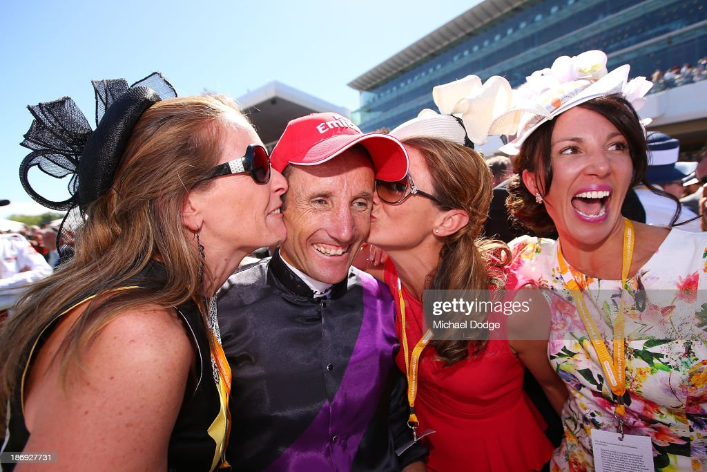 <a gi-track='captionPersonalityLinkClicked' href=/galleries/search?phrase=Damien+Oliver&family=editorial&specificpeople=210504 ng-click='$event.stopPropagation()'>Damien Oliver</a> gets kissed by part owners after riding Fiorente to win race 7 The Emirates Melbourne Cup during Melbourne Cup Day at Flemington Racecourse on November 5, 2013 in Melbourne, Australia.