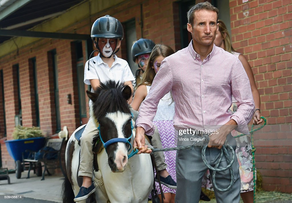 <a gi-track='captionPersonalityLinkClicked' href=/galleries/search?phrase=Damien+Oliver&family=editorial&specificpeople=210504 ng-click='$event.stopPropagation()'>Damien Oliver</a> parading his son Luke Oliver riding a pony during the launch of 'Relaxed Racing' carnival at Caulfield Racecourse on February 11, 2016 in Melbourne, Australia.