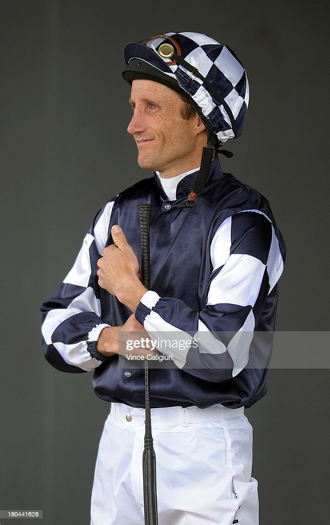 <a gi-track='captionPersonalityLinkClicked' href=/galleries/search?phrase=Damien+Oliver&family=editorial&specificpeople=210504 ng-click='$event.stopPropagation()'>Damien Oliver</a> prepares for his ride in Race 2 during Geelong racing on September 13, 2013 in Geelong, Australia. <a gi-track='captionPersonalityLinkClicked' href=/galleries/search?phrase=Damien+Oliver&family=editorial&specificpeople=210504 ng-click='$event.stopPropagation()'>Damien Oliver</a> returned to race riding today after serving a 10-month ban for betting on a rival horse and rode a winner with his first ride back.