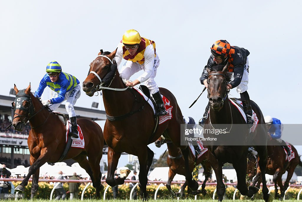 Damien Oliver rides Preferment to win race seven the AMMI Victoria Derby on Derby Day at Flemington Racecourse on November 1 2014 in Melbourne...