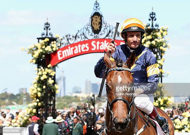 Damien Oliver rides Rhythm to Spare returns to scale after winning race 5 the Antler Luggage Handicap on Stakes Day at Flemington Racecourse on...