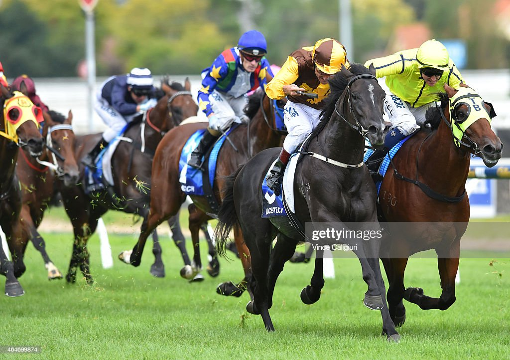 <a gi-track='captionPersonalityLinkClicked' href=/galleries/search?phrase=Damien+Oliver&family=editorial&specificpeople=210504 ng-click='$event.stopPropagation()'>Damien Oliver</a> riding Alpine Eagle (L) races past Nicholas Hall riding Firehouse Rock to win Race 4, the Caulfield Autumn Stakes during Blue Diamond Day at Caulfield Racecourse on February 28, 2015 in Melbourne, Australia.