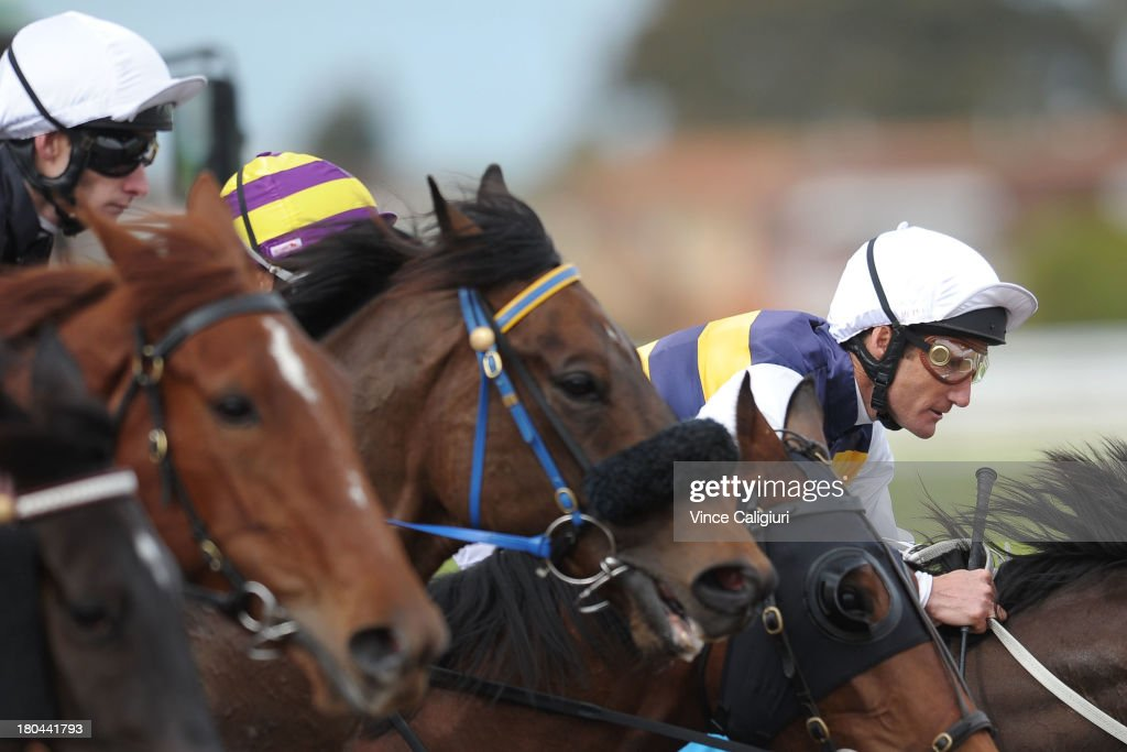 <a gi-track='captionPersonalityLinkClicked' href=/galleries/search?phrase=Damien+Oliver&family=editorial&specificpeople=210504 ng-click='$event.stopPropagation()'>Damien Oliver</a> riding Campeao in Race 3 during Geelong racing on September 13, 2013 in Geelong, Australia. <a gi-track='captionPersonalityLinkClicked' href=/galleries/search?phrase=Damien+Oliver&family=editorial&specificpeople=210504 ng-click='$event.stopPropagation()'>Damien Oliver</a> returned to race riding today after serving a 10-month ban for betting on a rival horse and rode a winner with his first ride back in Race 1.