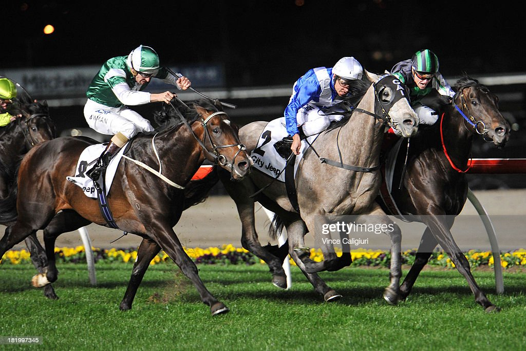 <a gi-track='captionPersonalityLinkClicked' href=/galleries/search?phrase=Damien+Oliver&family=editorial&specificpeople=210504 ng-click='$event.stopPropagation()'>Damien Oliver</a> riding Divine Calling defeats Hugh Bowman riding Cluster (L) and Craig Williams riding Shamus Award (R) in the City Jeep Stutt Stakes during Moonee Valley Racing at Moonee Valley Racecourse on September 27, 2013 in Melbourne, Australia.