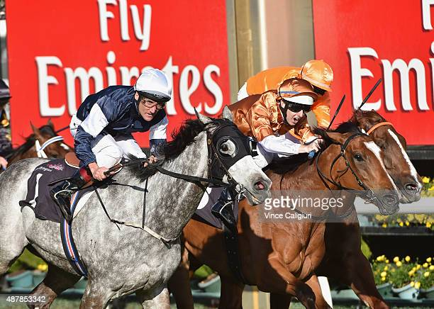 Damien Oliver riding Fawker defeats Damian Lane riding Rising Romance in Race 7 the Makybe Diva Stakes during Melbourne Racing at Flemington...