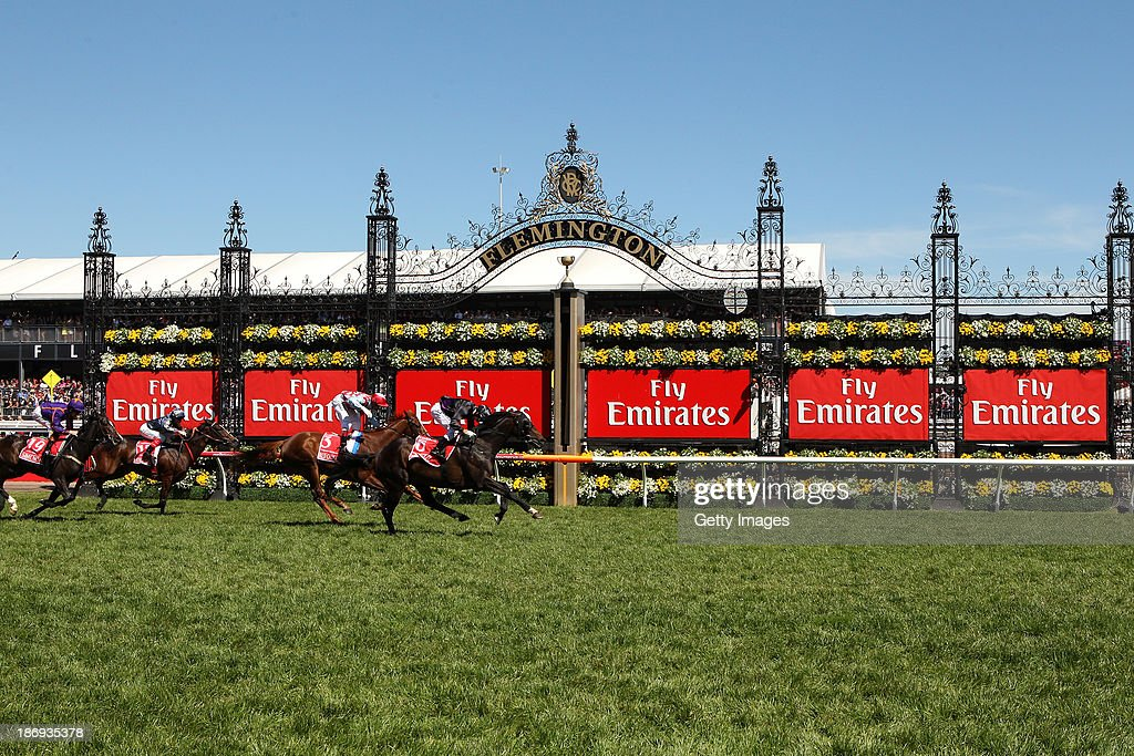 <a gi-track='captionPersonalityLinkClicked' href=/galleries/search?phrase=Damien+Oliver&family=editorial&specificpeople=210504 ng-click='$event.stopPropagation()'>Damien Oliver</a> riding Fiorente celebrates as he crosses the line to win race 7 the Emirates Melbourne Cup during Melbourne Cup Day at Flemington Racecourse on November 5, 2013 in Melbourne, Australia.