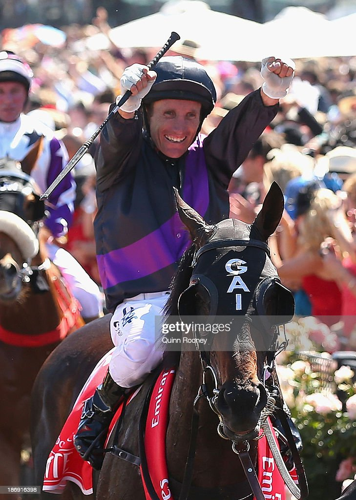 Damien Oliver riding Fiorente celebrates as he returns to scale after winning race 7 the Emirates Melbourne Cup during Melbourne Cup Day at Flemington Racecourse on November 5, 2013 in Melbourne, Australia.