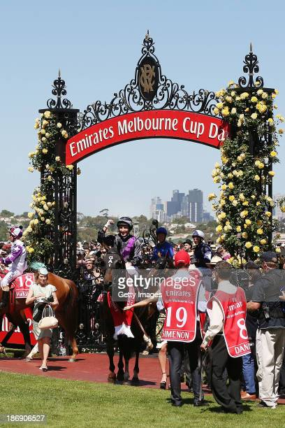 Damien Oliver riding Fiorente celebrates winning race 7 The Emirates Melbourne Cup during Melbourne Cup Day at Flemington Racecourse on November 5...