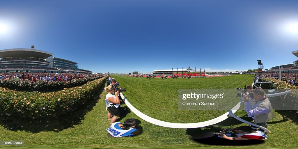 <a gi-track='captionPersonalityLinkClicked' href=/galleries/search?phrase=Damien+Oliver&family=editorial&specificpeople=210504 ng-click='$event.stopPropagation()'>Damien Oliver</a> riding Fiorente celebrates winning race 7 The Emirates Melbourne Cup during Melbourne Cup Day at Flemington Racecourse on November 5, 2013 in Melbourne, Australia.