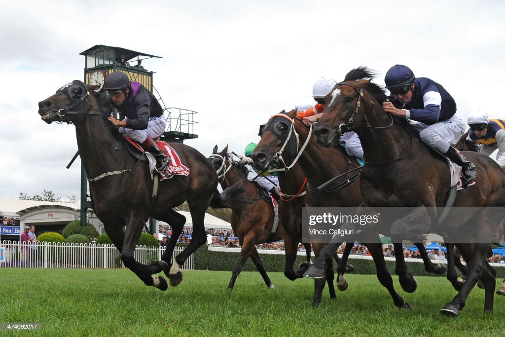 <a gi-track='captionPersonalityLinkClicked' href=/galleries/search?phrase=Damien+Oliver&family=editorial&specificpeople=210504 ng-click='$event.stopPropagation()'>Damien Oliver</a> riding Fiorente (L) defeats Steven Arnold riding Mourayan in Race 5, the Carlton Draught Peter Young Stakes during Blue Diamond Stakes Day at Caulfield Racecourse on February 22, 2014 in Melbourne, Australia.
