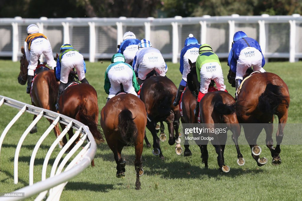 Damien Oliver (R) riding Happy Clapper copped a 20 meeting suspsension after repeatedly bumping into Dean Yendall riding Royal Symphony here during Cox Plate Day at Moonee Valley Racecourse on October 28, 2017 in Melbourne, Australia.
