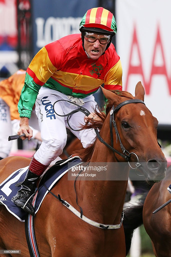 Damien Oliver riding Happy Trails celebrates winning race 6 the Longines Mackinnon Stakes on Derby Day at Flemington Racecourse on November 1, 2014 in Melbourne, Australia.