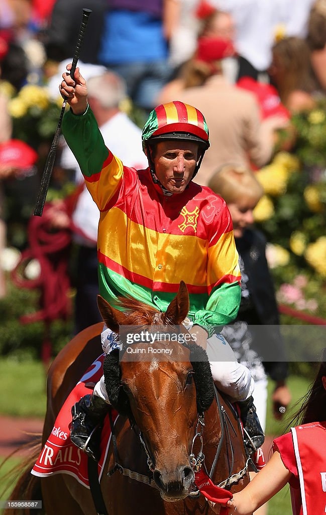 <a gi-track='captionPersonalityLinkClicked' href=/galleries/search?phrase=Damien+Oliver&family=editorial&specificpeople=210504 ng-click='$event.stopPropagation()'>Damien Oliver</a> riding Happy Trails celebrates winning the Emirates Stakes during 2012 Emirates Stakes Day at Flemington Racecourse on November 10, 2012 in Melbourne, Australia.