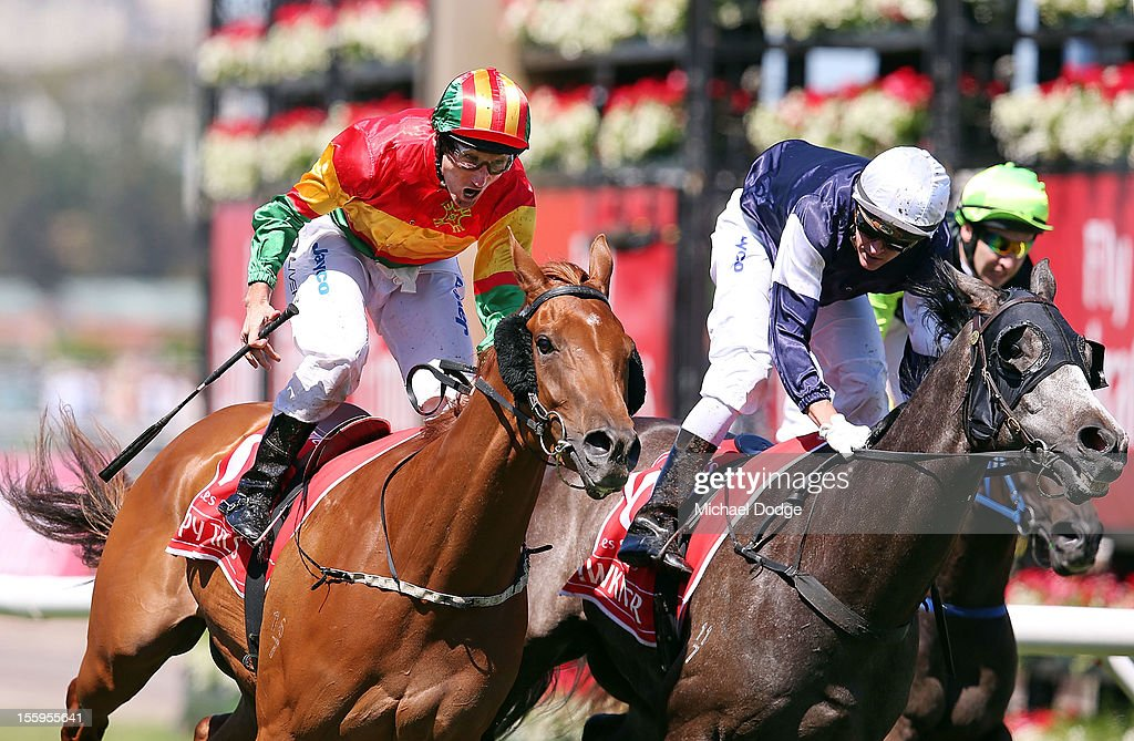 <a gi-track='captionPersonalityLinkClicked' href=/galleries/search?phrase=Damien+Oliver&family=editorial&specificpeople=210504 ng-click='$event.stopPropagation()'>Damien Oliver</a> riding Happy Trails wins the Emirates Stakes during 2012 Emirates Stakes Day at Flemington Racecourse on November 10, 2012 in Melbourne, Australia.