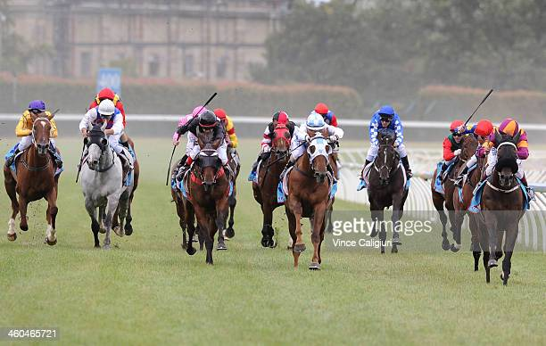 Damien Oliver riding Initiator winning Race 8 during Melbourne Racing at Caulfield Racecourse on January 4 2014 in Melbourne Australia
