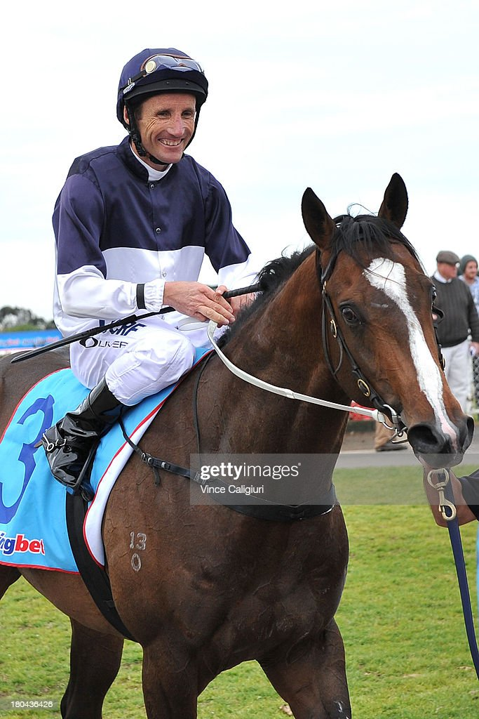 <a gi-track='captionPersonalityLinkClicked' href=/galleries/search?phrase=Damien+Oliver&family=editorial&specificpeople=210504 ng-click='$event.stopPropagation()'>Damien Oliver</a> riding Lion of Belfort after winning the Geelong & Surf Coast Limo Bus Maiden Plate during Geelong racing on September 13, 2013 in Geelong, Australia. <a gi-track='captionPersonalityLinkClicked' href=/galleries/search?phrase=Damien+Oliver&family=editorial&specificpeople=210504 ng-click='$event.stopPropagation()'>Damien Oliver</a> returned to race riding today after serving a 10-month ban for betting on a rival horse and rode a winner with his first ride back.