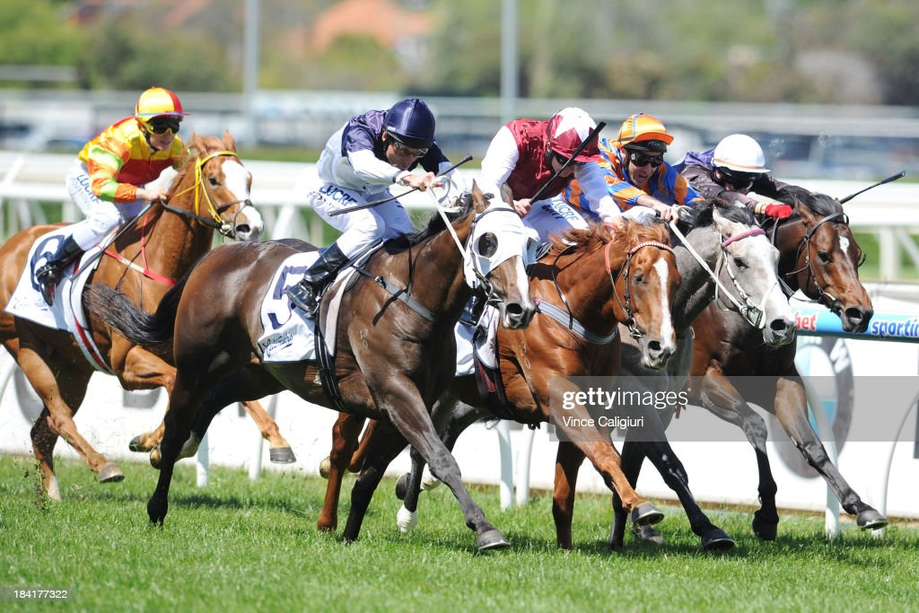 <a gi-track='captionPersonalityLinkClicked' href=/galleries/search?phrase=Damien+Oliver&family=editorial&specificpeople=210504 ng-click='$event.stopPropagation()'>Damien Oliver</a> riding Lion of Belfort wins from Kerrin McEvoy, <a gi-track='captionPersonalityLinkClicked' href=/galleries/search?phrase=Michael+Rodd&family=editorial&specificpeople=850617 ng-click='$event.stopPropagation()'>Michael Rodd</a> riding Villa Verde and <a gi-track='captionPersonalityLinkClicked' href=/galleries/search?phrase=Brett+Prebble&family=editorial&specificpeople=646298 ng-click='$event.stopPropagation()'>Brett Prebble</a> riding Va Pensiero and Lauren Stojakovic riding Miracles of Life (L) in the Catanach's Jewellers Blue Sapphire during Melbourne Racing at Caulfield Racecourse on October 12, 2013 in Melbourne, Australia.