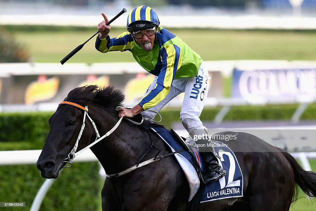 <a gi-track='captionPersonalityLinkClicked' href=/galleries/search?phrase=Damien+Oliver&family=editorial&specificpeople=210504 ng-click='$event.stopPropagation()'>Damien Oliver</a> riding Lucia Valentina celebrates winning Race 9 in the Longines Queen Elizabeth Stakes during Queen Elizabeth Stakes Day at Royal Randwick Racecourse on April 9, 2016 in Sydney, Australia.