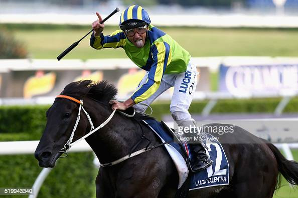 Damien Oliver riding Lucia Valentina celebrates winning Race 9 in the Longines Queen Elizabeth Stakes during Queen Elizabeth Stakes Day at Royal...