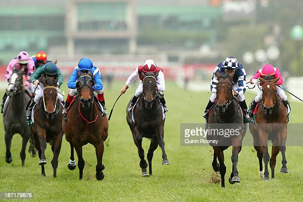 Damien Oliver riding Melrose Place crosses the line to win race 3 the Gucci Icons of Heritage Stakes during Oaks Day at Flemington Racecourse on...