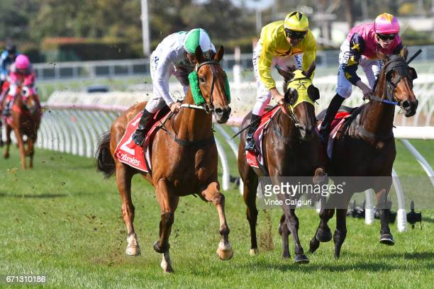 Damien Oliver riding Refectory defeats Dwayne Dunn riding Bayanova and Ben Allen riding Shampion in Race 1 during Melbourne Racing at Caulfield...