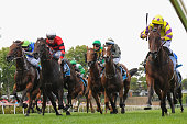 Damien Oliver riding Rocky Boomboa defeats Mark Zahra riding Love Days in Race 5 at Moonee Valley Racecourse on January 2 2016 in Melbourne Australia