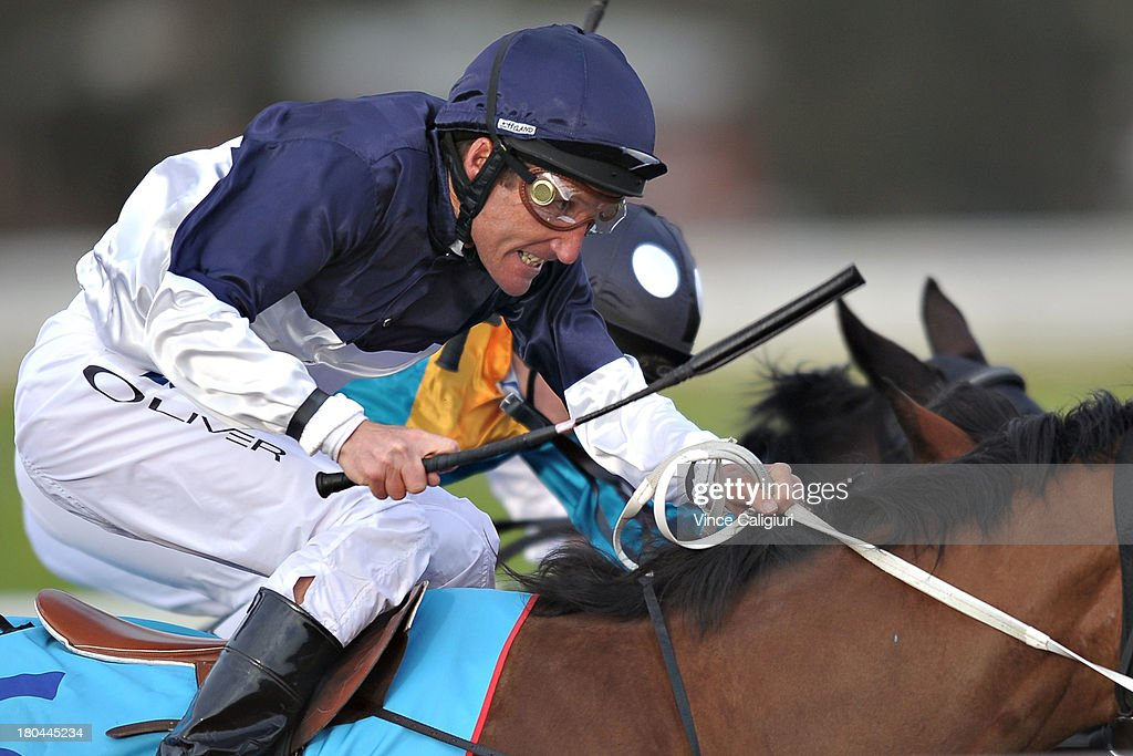 <a gi-track='captionPersonalityLinkClicked' href=/galleries/search?phrase=Damien+Oliver&family=editorial&specificpeople=210504 ng-click='$event.stopPropagation()'>Damien Oliver</a> riding Showmya Miss in Race 6 during Geelong racing on September 13, 2013 in Geelong, Australia. <a gi-track='captionPersonalityLinkClicked' href=/galleries/search?phrase=Damien+Oliver&family=editorial&specificpeople=210504 ng-click='$event.stopPropagation()'>Damien Oliver</a> returned to race riding today after serving a 10-month ban for betting on a rival horse and rode a winner with his first ride back in Race 1.