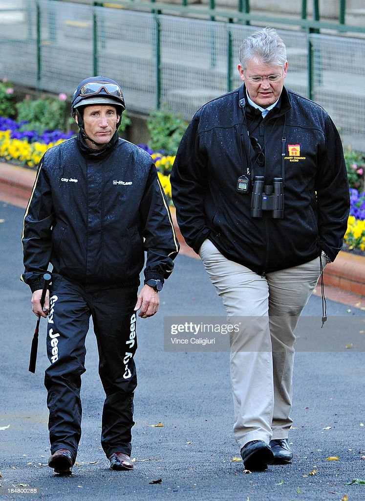 <a gi-track='captionPersonalityLinkClicked' href=/galleries/search?phrase=Damien+Oliver&family=editorial&specificpeople=210504 ng-click='$event.stopPropagation()'>Damien Oliver</a> talks with trainer Anthony Cummings after a trackwork session at Moonee Valley Racecourse on October 17, 2013 in Melbourne, Australia.