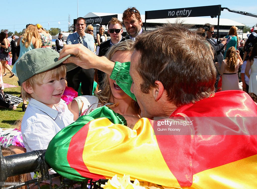 <a gi-track='captionPersonalityLinkClicked' href=/galleries/search?phrase=Damien+Oliver&family=editorial&specificpeople=210504 ng-click='$event.stopPropagation()'>Damien Oliver</a> who rode Happy Trails to win the Emirates Stakes celebrates with his son Luke Oliver during 2012 Emirates Stakes Day at Flemington Racecourse on November 10, 2012 in Melbourne, Australia.