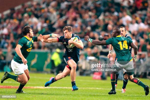 Damien Penaud of France avoids a tackle during the International test match between South Africa and France at the Kingspark rugby stadium on June 17...