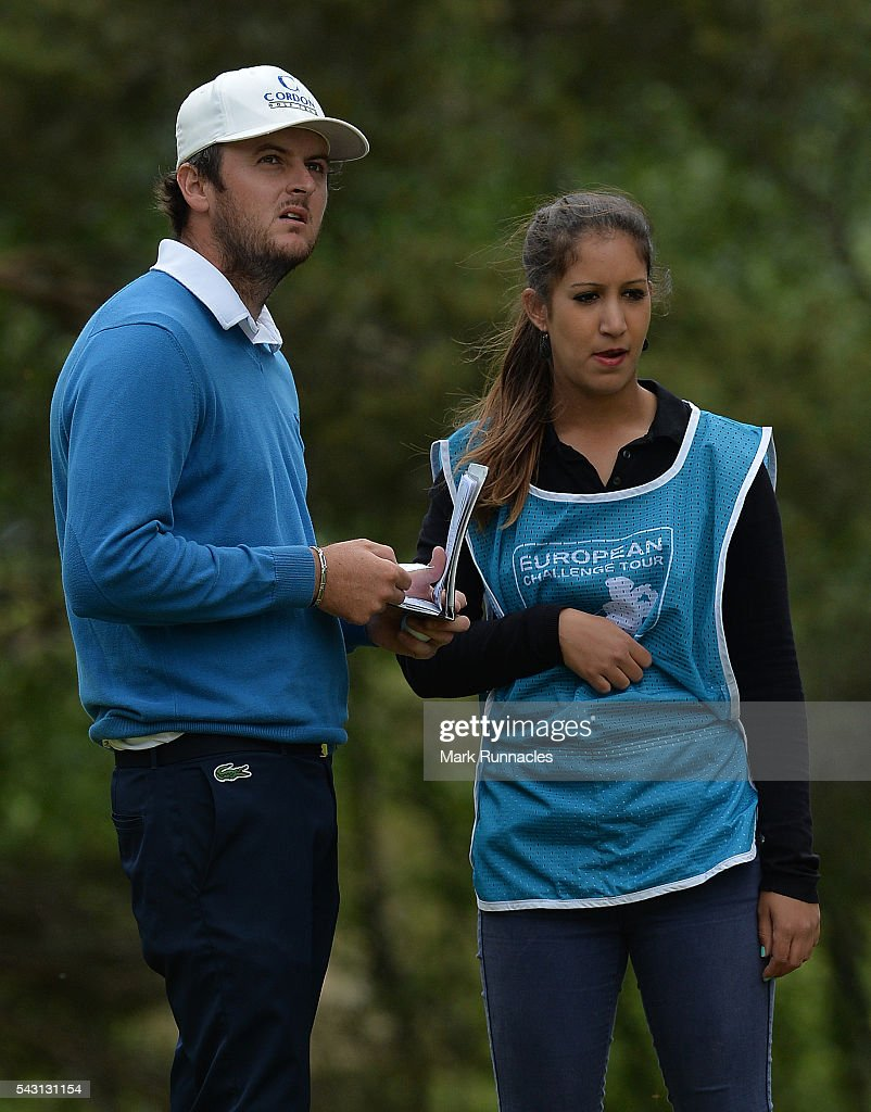 Damien Perrier of France talks with his caddie at the 8th Tee during the final day of the 2016 SSE Scottish Hydro Challenge at the MacDonald Spey Valley Golf Course on June 26, 2016 in Aviemore, Scotland.