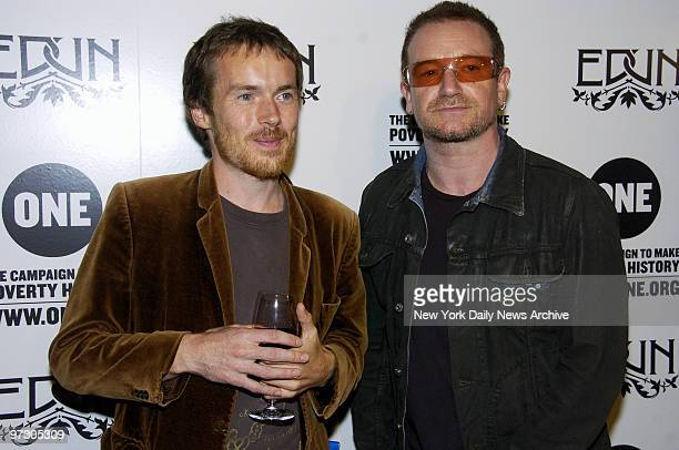 Damien Rice and U2 singer Bono arrive for a party at the Hudson Hotel to launch the Campaign To Make Poverty History's new ONE Tshirt made of African...