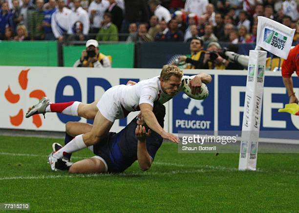 13 Damien Traille of France fails to stop Josh Lewsey of England from scoring the opening try during the Rugby World Cup 2007 Semi Final match...
