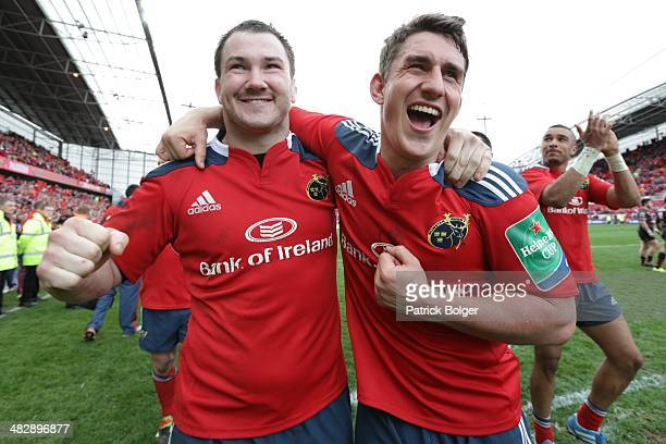 Damien Varley and Ian Keatley of Munster celebrate victory after the Heineken Cup Quarter Final match between Munster and Toulouse at Thomond Park on...