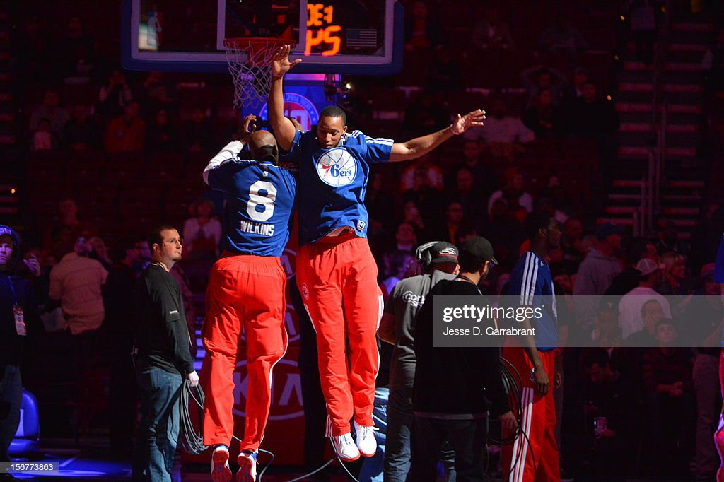Damien Wilkins #8 and Evan Turner #12 of the Philadelphia 76ers greet each other before the game against the Toronto Raptors at the Wells Fargo Center on November 20, 2012 in Philadelphia, Pennsylvania.