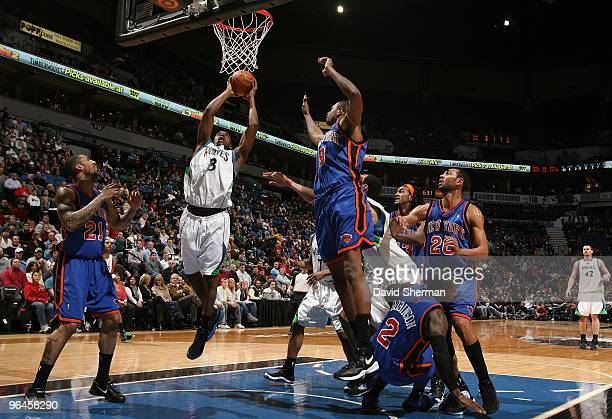 Damien Wilkins of the Minnesota Timberwolves goes up for a shot against Wilson Chandler and Jonathan Bender of the New York Knicks during the game at...