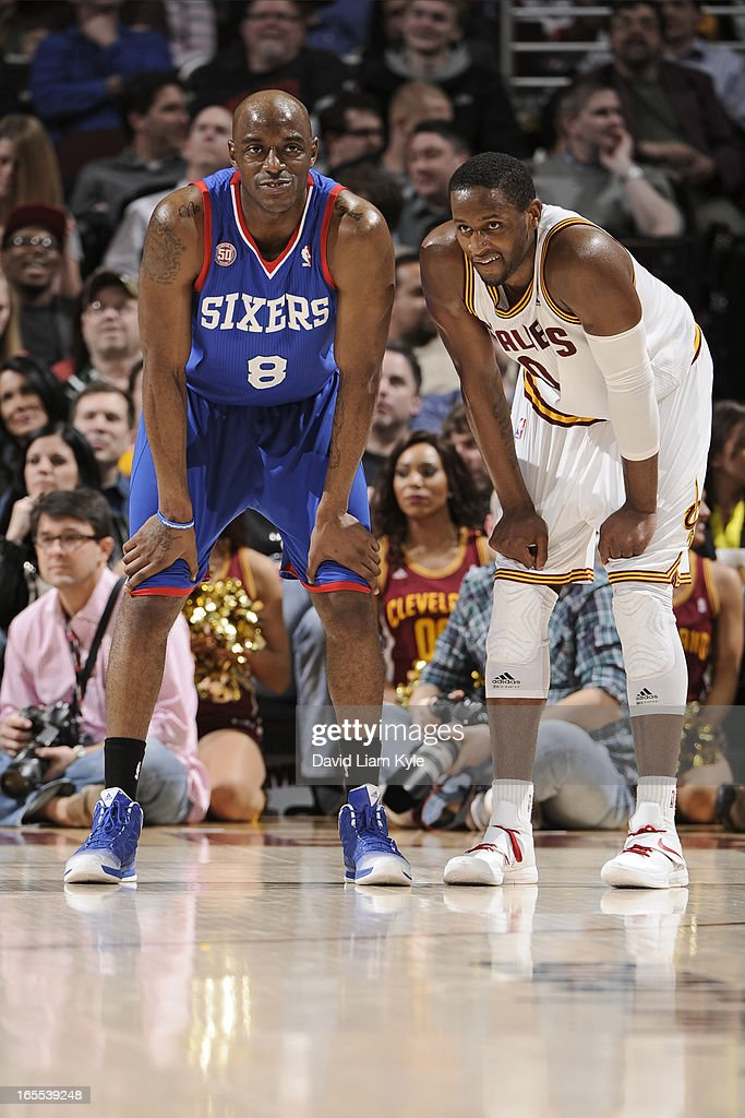 <a gi-track='captionPersonalityLinkClicked' href=/galleries/search?phrase=Damien+Wilkins&family=editorial&specificpeople=204651 ng-click='$event.stopPropagation()'>Damien Wilkins</a> #8 of the Philadelphia 76ers and C.J. Miles #0 of the Cleveland Cavaliers stand on the court during the game at The Quicken Loans Arena on March 29, 2013 in Cleveland, Ohio.