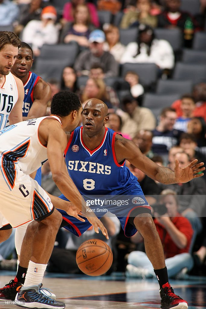 Damien Wilkins #8 of the Philadelphia 76ers defends against Gerald Henderson #9 of the Charlotte Bobcats at the Time Warner Cable Arena on April 3, 2013 in Charlotte, North Carolina.