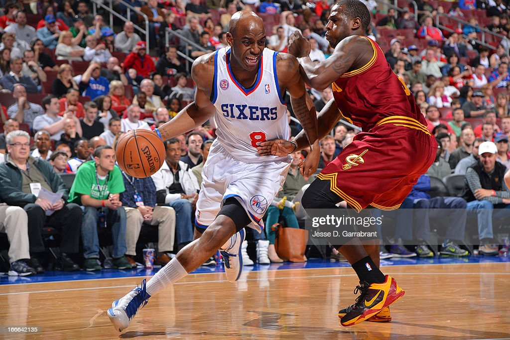 Damien Wilkins #8 of the Philadelphia 76ers drives against Dion Waiters #3 of the Cleveland Cavaliers at the Wells Fargo Center on April 14, 2013 in Philadelphia, Pennsylvania.