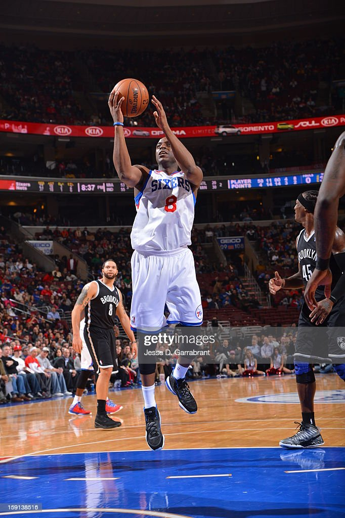 <a gi-track='captionPersonalityLinkClicked' href=/galleries/search?phrase=Damien+Wilkins&family=editorial&specificpeople=204651 ng-click='$event.stopPropagation()'>Damien Wilkins</a> #8 of the Philadelphia 76ers drives to the basket against the Brooklyn Nets during the game at the Wells Fargo Center on January 8, 2013 in Philadelphia, Pennsylvania.