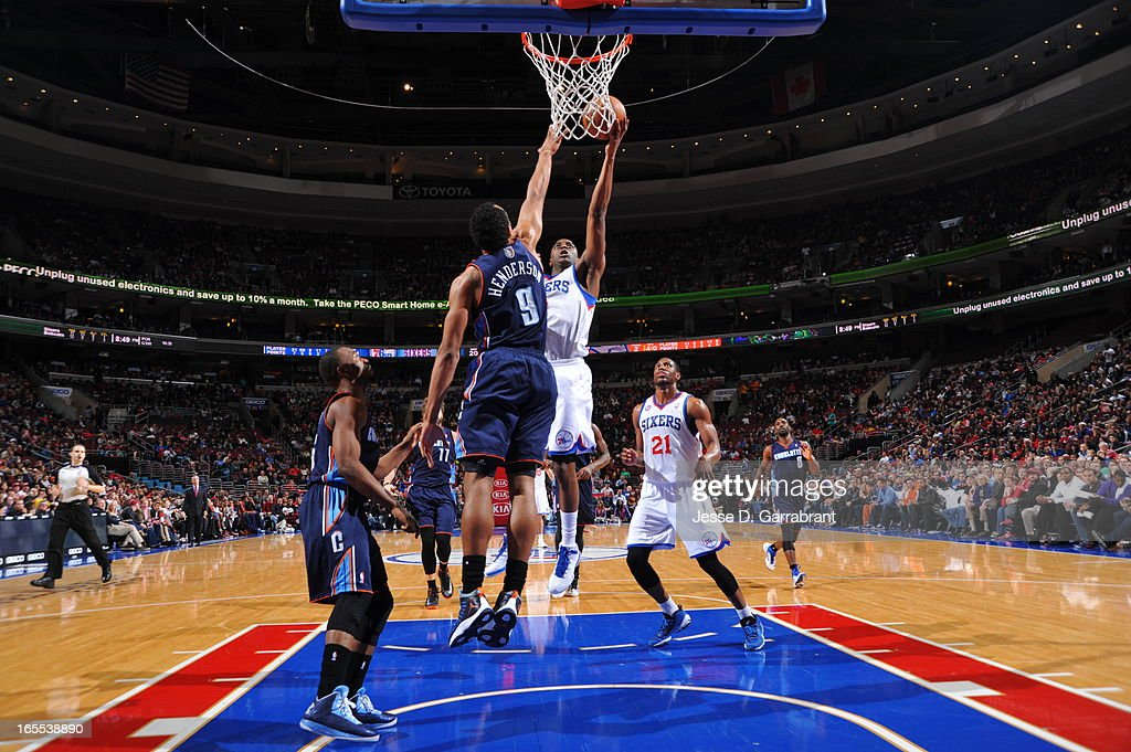 Damien Wilkins #8 of the Philadelphia 76ers drives to the basket against the Charlotte Bobcats at the Wells Fargo Center on March 30, 2013 in Philadelphia, Pennsylvania.