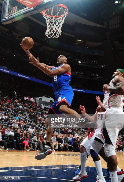 Damien Wilkins of the Philadelphia 76ers glides to the basket for the layup against the Atlanta Hawks on April 5 2013 at Philips Arena in Atlanta...