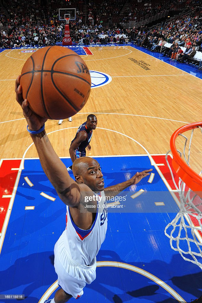 Damien Wilkins #8 of the Philadelphia 76ers goes to the basket against the Charlotte Bobcats at the Wells Fargo Center on March 30, 2013 in Philadelphia, Pennsylvania.