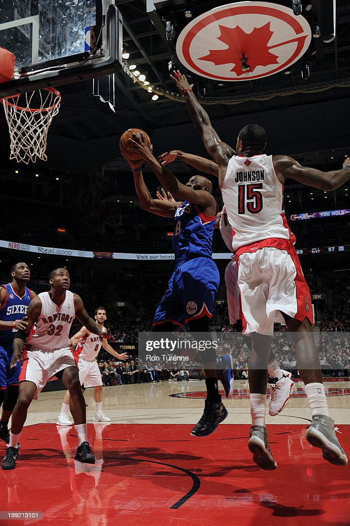 Damien Wilkins #8 of the Philadelphia 76ers goes up for the layup against Amir Johnson #15 of the Toronto Raptors during the game on January 9, 2013 at the Air Canada Centre in Toronto, Ontario, Canada.