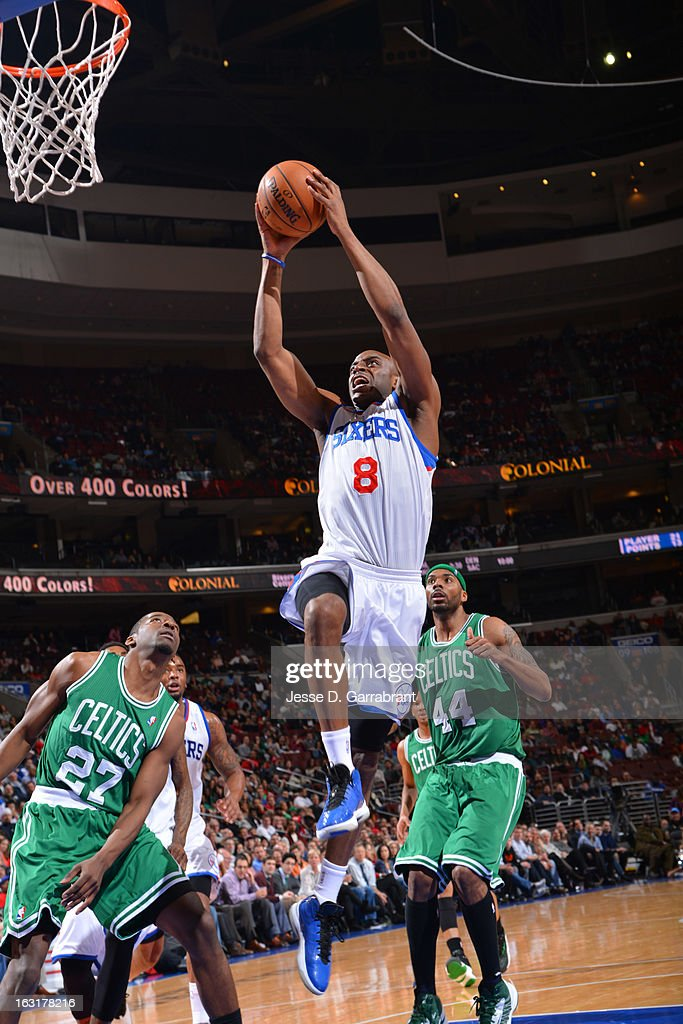 Damien Wilkins #8 of the Philadelphia 76ers rises for a dunk against Jordan Crawford #27 and Chris Wilcox #44 of the Boston Celtics on March 5, 2013 at the Wells Fargo Center in Philadelphia, Pennsylvania.