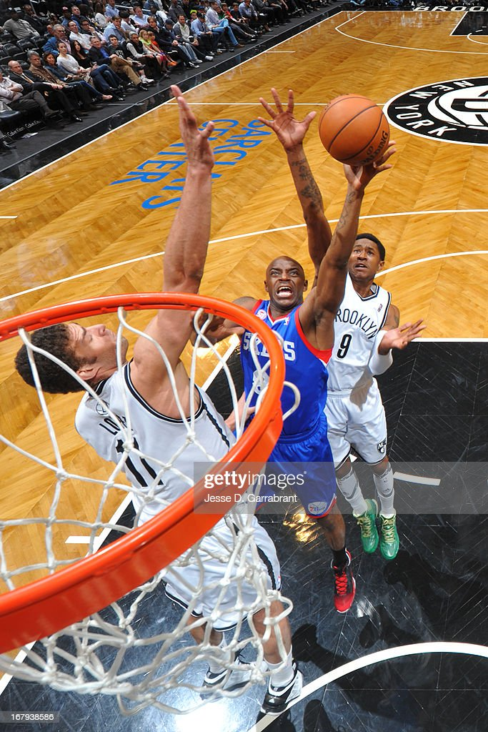 <a gi-track='captionPersonalityLinkClicked' href=/galleries/search?phrase=Damien+Wilkins&family=editorial&specificpeople=204651 ng-click='$event.stopPropagation()'>Damien Wilkins</a> #8 of the Philadelphia 76ers shoots against <a gi-track='captionPersonalityLinkClicked' href=/galleries/search?phrase=Brook+Lopez&family=editorial&specificpeople=3847328 ng-click='$event.stopPropagation()'>Brook Lopez</a> #11 and <a gi-track='captionPersonalityLinkClicked' href=/galleries/search?phrase=MarShon+Brooks&family=editorial&specificpeople=4884862 ng-click='$event.stopPropagation()'>MarShon Brooks</a> #9 of the Brooklyn Nets on April 9, 2013 at the Barclays Center in Brooklyn, New York.
