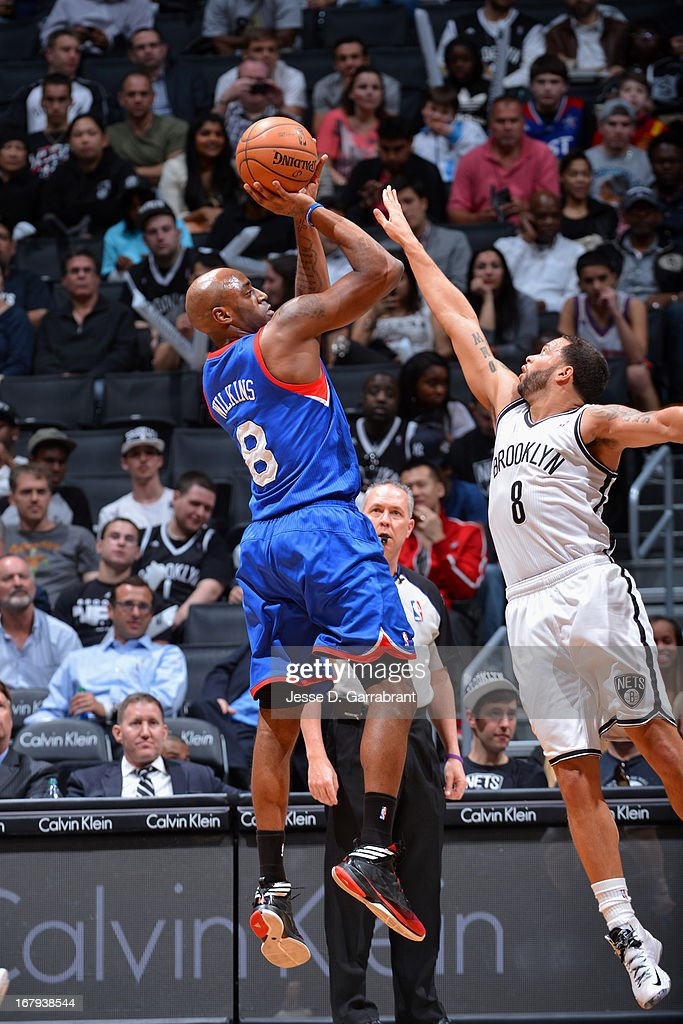 <a gi-track='captionPersonalityLinkClicked' href=/galleries/search?phrase=Damien+Wilkins&family=editorial&specificpeople=204651 ng-click='$event.stopPropagation()'>Damien Wilkins</a> #8 of the Philadelphia 76ers shoots against <a gi-track='captionPersonalityLinkClicked' href=/galleries/search?phrase=Deron+Williams&family=editorial&specificpeople=203215 ng-click='$event.stopPropagation()'>Deron Williams</a> #8 of the Brooklyn Nets on April 9, 2013 at the Barclays Center in Brooklyn, New York.