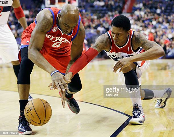Damien Wilkins of the Philadelphia 76ers steals the ball from Bradley Beal of the Washington Wizards during the first half at Verizon Center on March...