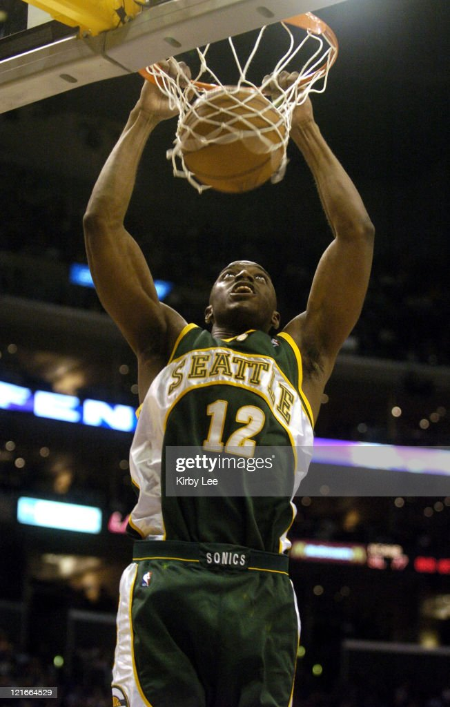 <a gi-track='captionPersonalityLinkClicked' href=/galleries/search?phrase=Damien+Wilkins&family=editorial&specificpeople=204651 ng-click='$event.stopPropagation()'>Damien Wilkins</a> of the Seattle SuperSonics dunks during the game between the Seattle SuperSonics and the Los Angeles Lakers at the Staples Center in Los Angeles, California, on March 20, 2005. The SuperSonics defeated the Lakers 102-100.